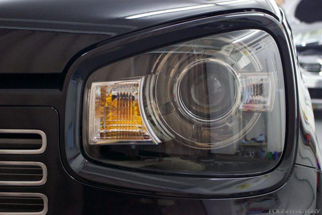 ガラスコーティングで入庫中のスズキアルトワークス新車のヘッドライト画像